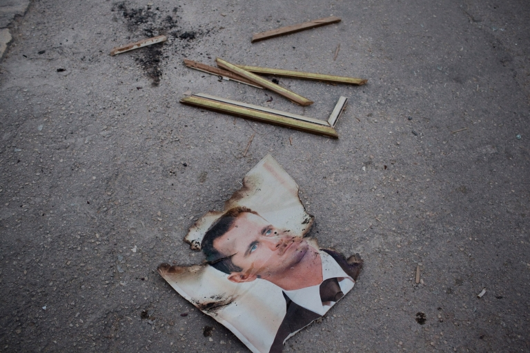 <p>A destroyed photo of Syrian President Bashar al-Assad on the grounds of the Al Ansari police station in the Sikari neighborhood of Aleppo.</p>