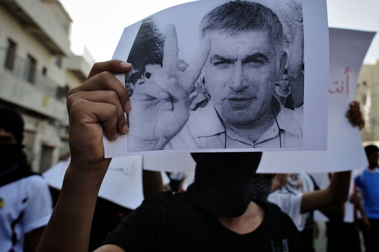 <p>A Bahraini Shiite Muslim youth holds a picture of prominent rights activist Nabeel Rajab during a demonstration in his solidarity along with jailed dissident Abdulhadi Khawaja in the village of Daih, west of Manama, on June 11, 2012.</p>
