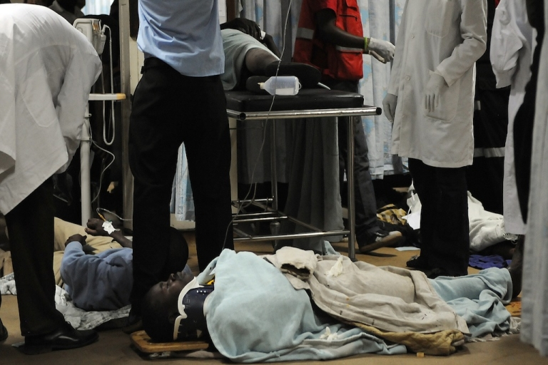 <p>A man is assisted into the hospital on Mar. 10, 2012 after a bomb attack at a bus station in Nairobi that killed at least three people and wounded more than 20 others.</p>