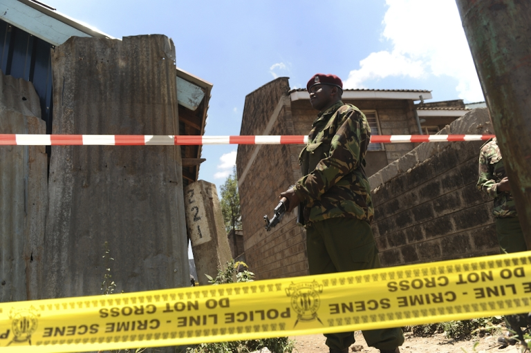 <p>A policeman stands guard next to the scene where a blast ripped through a church in Nairobi on September 30, 2012. A suspected grenade attack killed one child and wounded nine others in a Nairobi church today, a day after Islamist fighters abandoned their last bastion in neighbouring Somalia in the face of an assault by Kenyan and other troops.</p>