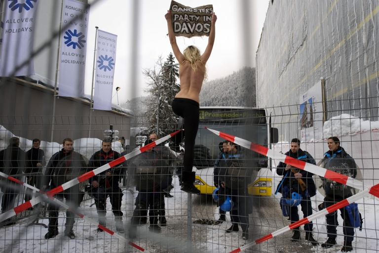 <p>An activist from the Ukrainian group FEMEN shouts slogans during a topless protest at the World Economic Forum in the Swiss resort of Davos on Jan. 28, 2012.</p>