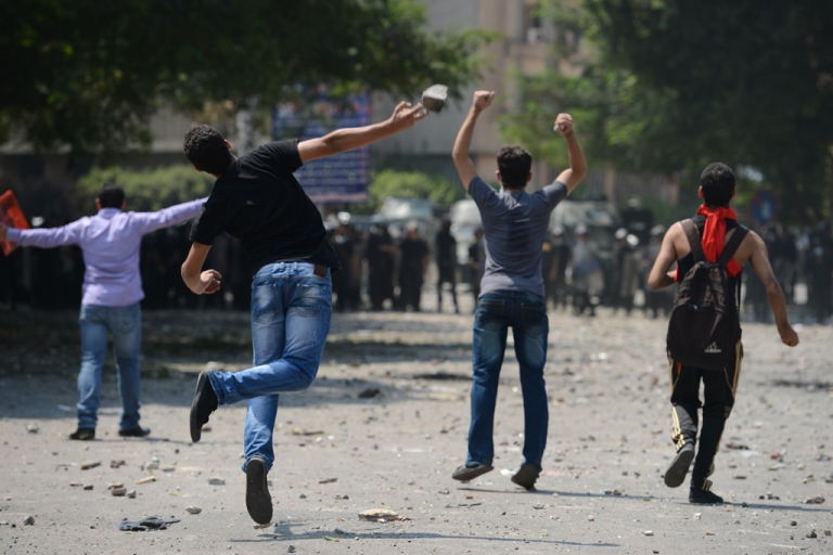 <p>Egyptian protesters clash with riot police near the US embassy in Cairo on September 13, 2012. Police used tear gas as they clashed with a crowd protesting outside the US embassy in Cairo against a film mocking Islam.</p>