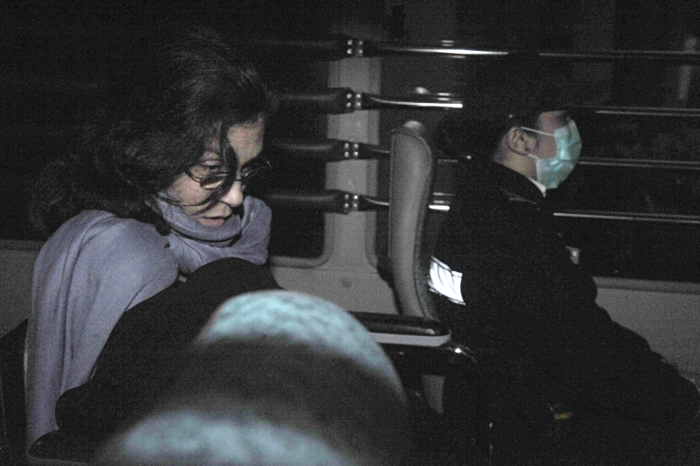 <p>Nancy Kissel (L) leaves the High Court aboard a Correctional Services Department bus in Hong Kong on March 25, 2011. A Hong Kong jury convicted US housewife Kissel of murder over the 2003 killing of her banker husband, in a retrial of a lurid case dubbed the 'Milkshake Murder'. The Michigan-born mother-of-three won a new hearing last year into the killing of Robert Kissel, a senior executive at Merrill Lynch, after her 2005 murder conviction was quashed due to legal errors at the first trial.</p>