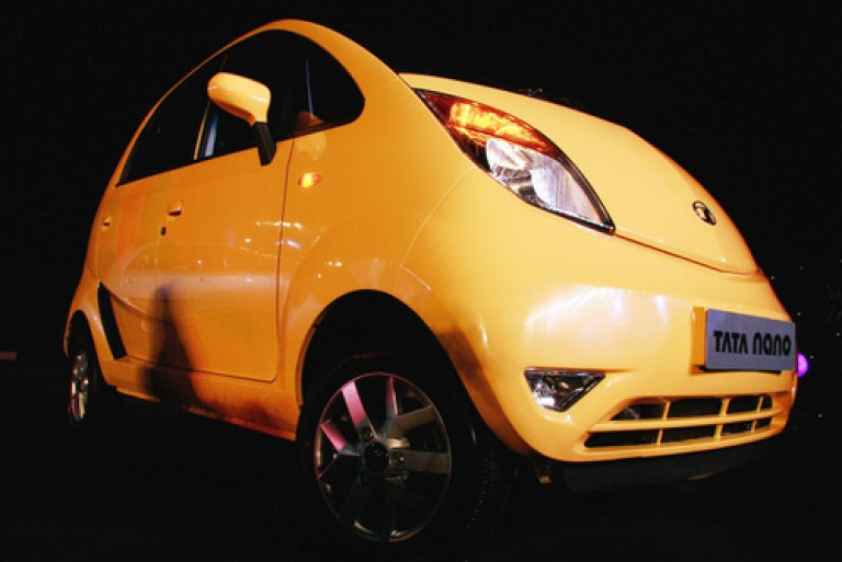 <p>Shown here at the March 23, 2009 launch in Mumbai, the Tata Nano created a media sensation. But the world's cheapest car has been plagued with problems from the beginning.  Now Tata Motors is recalling about 140,000 Nanos so that the starter can be replaced -- a move that may cost the company as much as $22 million.</p>