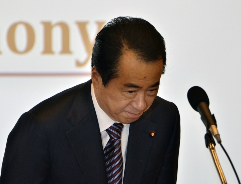 <p>Japanese Prime Minister Naoto Kan bows as he delivers an opening speech at a UN meeting in Tokyo on June 2, 2011.</p>