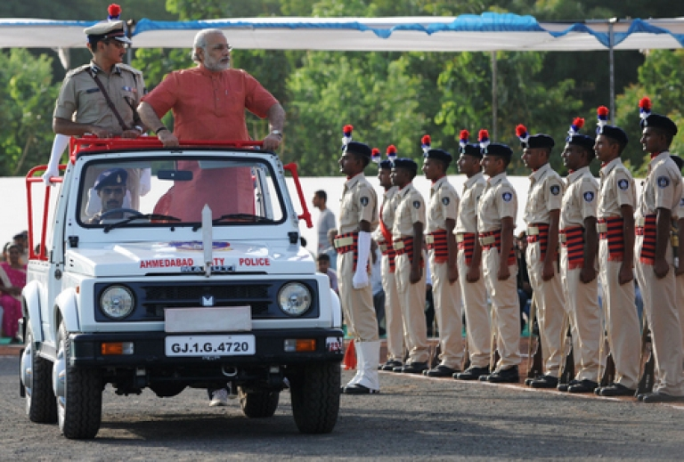<p>Gujarat state Chief Minister Narendra Modi (2R) inspects a Guard of Honour during a passing out parade at the Gujarat Police Academy in Karai near Gandhinagar, some 30 kms from Ahmedabad on June 11, 2012. The Hindu nationalist leader is arguably the popular choice of the party faithful to be the Bharatiya Janata Party's (BJP) next candidate for prime minister. But he has entrenched opponents within the upper echelons of the BJP, and faces questions over whether he would be acceptable to the party's inevitable coalition partners.</p>