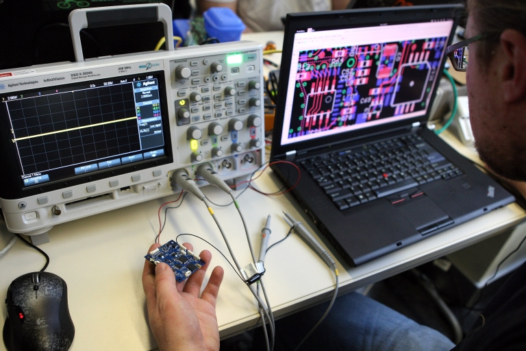 <p>A particpant checks a circuit board next to an oscilloscope on the first day of the 28th Chaos Communication Congress (28C3) - Behind Enemy Lines computer hacker conference on December 27, 2011 in Berlin, Germany.</p>