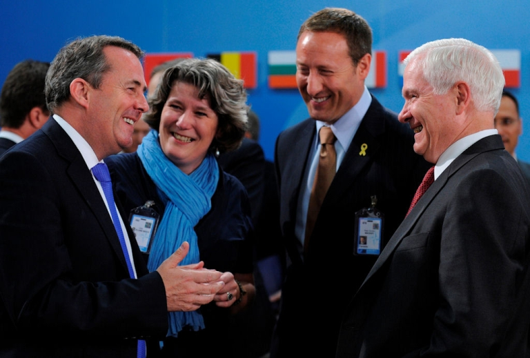 <p>Two days before giving a speech excoriating America's NATO partners, U.S. Defense Secretary Robert Gates laughs with (from left) British Defense Secretary Liam Fox, Danish Defense Minister Bech Lillelund and Canadian Defense Minister Peter MacKay before a meeting at the alliance's Brussels headquarters. Britain, Denmark and Canada were among the