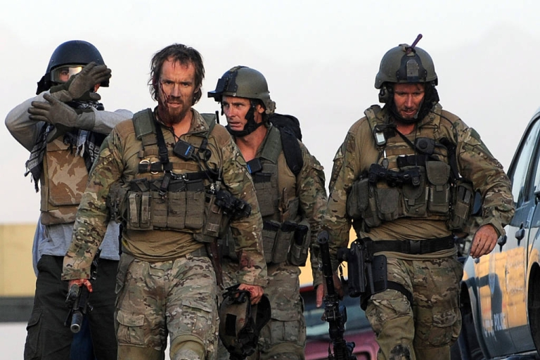 <p>Soldiers leave after taking part in a military operation against the Taliban, who attacked the Intercontinental Hotel in Kabul, Afghanistan, on June 29, 2011. The operation was backed up by a NATO helicopter.</p>