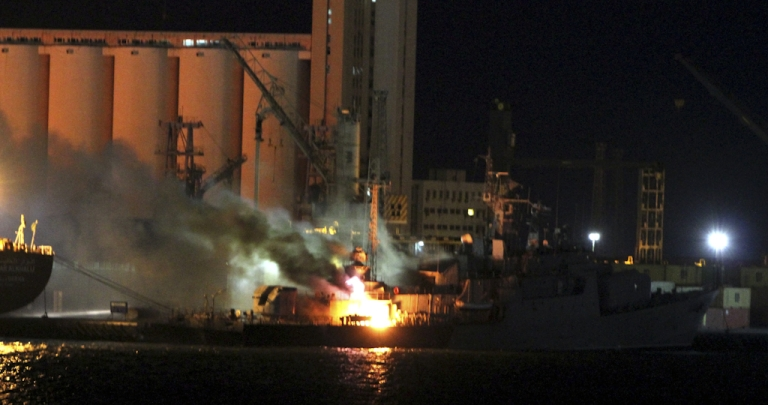 <p>Flames engulf a ship in the port of the Libyan capital Tripoli following NATO air strikes on May 19, 2011. Tripoli is targeted nearly daily with air raids by the international coalition, which launched strikes on March 19 to prevent Libyan strongman Moamer Kadhafi's forces from attacking civilians.</p>