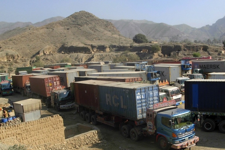 <p>A bus collided with a fuel tanker in Afghanistan today, killing at least 51 people. Here, trucks carrying supplies for NATO forces in Afghanistan are parked at the Pakistan's Torkham border crossing on November 26, 2011.</p>