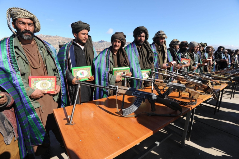 <p>A leaked NATO report has suggested that the Taliban still enjoy support and influence in Afghanistan, with the backing of Pakistan's spy agency, the ISI. The Taliban, ousted from power by a US-led invasion in the wake of the 9/11 attacks, announced earlier this month that they planned to set up a political office in Qatar ahead of talks with Washington. AFP PHOTO/ Aref KARIMI</p>