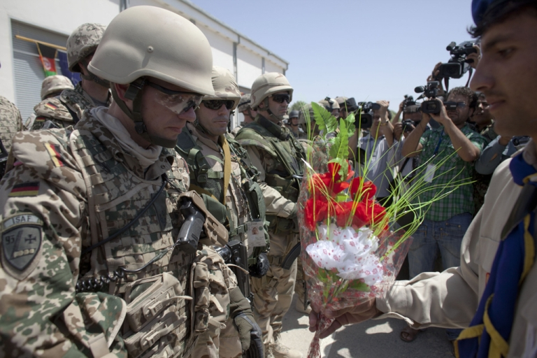 <p>German soldiers of NATO's International Security Assistance Force (ISAF) receive flowers during a security transition ceremony July 23, 2011 in Mazar-e-Sharif, the provincial capital of Balkh province, Afghanistan. The Afghan government officially took control of security from NATO forces in the capital of the peaceful northern province of Balkh , part of an effort to begin handing over all security responsibilities to Afghan forces by 2014, next is the city of Kabul.</p>