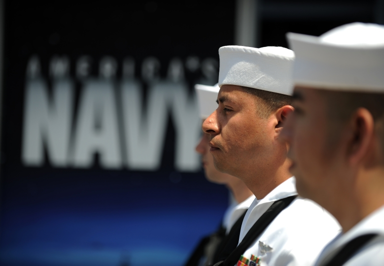 <p>US Navy sailors await the start of their re-enlistment ceremony in Los Angeles on July 28, 2011.</p>