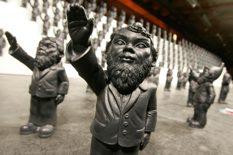 <p>An art installation titled 'Dance of/with the Devil' by German artist Ottmar Horl, featuring hundreds of Nazi-saluting garden gnomes, forms part of the the Flanders Expo - LineArt Exhibition on December 5, 2008 in Ghent, Belgium.</p>