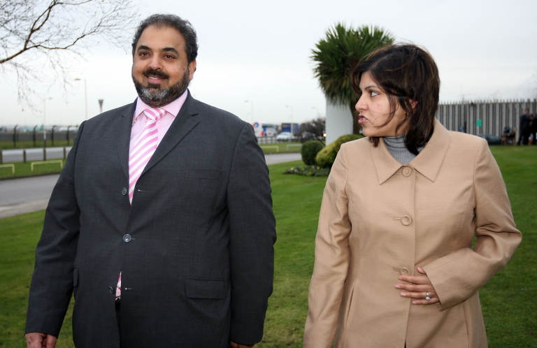 <p>Lord Ahmed talks with Baroness Warsi on arrival from Sudan at London Heathrow Airport in December, 2007.</p>