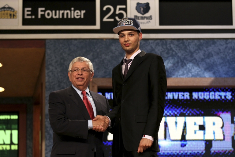 <p>NBA Commissioner David Stern, left, congratulates Evan Fournier of Saint-Maurice, France, during the NBA draft on Thursday night in Newark, NJ. The Denver Nuggets chose Fourier 20th overall.</p>