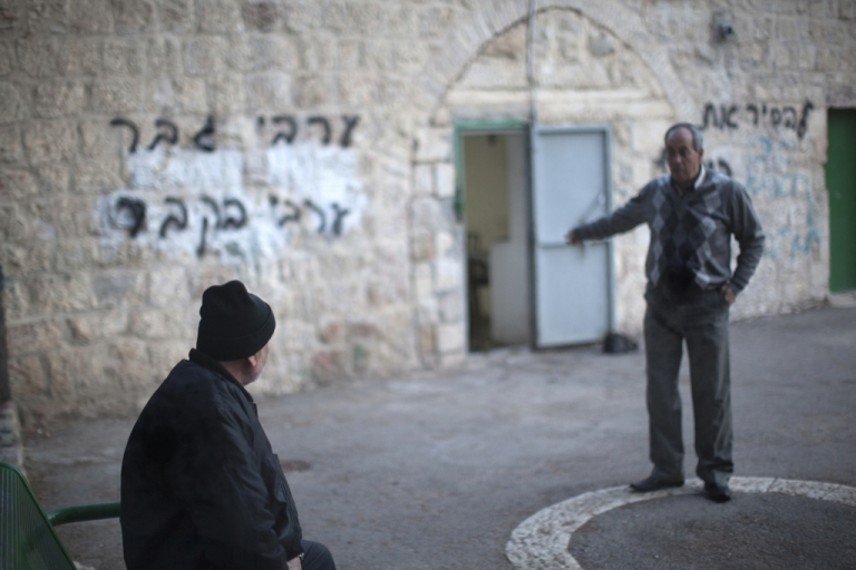 <p>A Palestinian municipal worker gestures at the vandalized walls of a disused mosque in a central neighborhood of Jerusalem, December 14, 2011.</p>