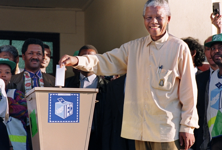<p>Mandela casts his vote in South Africa's first democratic and all-race general elections, April 27, 1994. The day is now celebrated in South Africa as Freedom Day.</p>