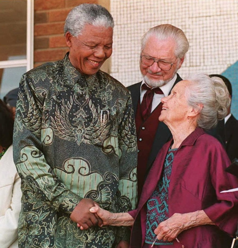 <p>President Mandela shakes hands with Bertie Verwoerd, the 94-year-old widow of the late prime minister and architect of apartheid, Hendriek French Verwoerd, in Orania, a whites-only settlement founded in 1991. Mandela said the purpose of his visit was '