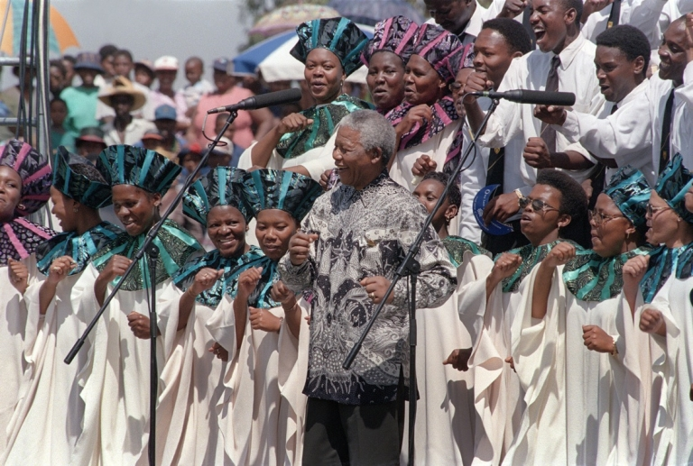<p>President Mandela celebrates the signing of South Africa's new constitution, on Dec. 10, 1996, in Sharpville stadium. The constitution is considered one of the most progressive in the world.</p>