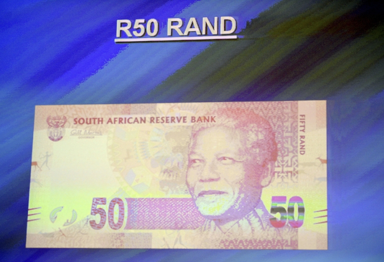<p>This picture taken on February 11, 2012 shows the new South African bank note of 50 Rand displayed on a screen during the announcement of a new line of bank notes in Pretoria. The new bank notes bear the former president's image Nelson Mandela circa 1990, the year he was freed from prison in a moment that came to symbolise the fall of apartheid and the rise of a new, democratic South Africa. They replace a design featuring the 'big five' safari animals (Cape buffalo, elephant, leopard, lion and rhino) introduced in 1992, two years before Mandela was elected the country's first black president.</p>