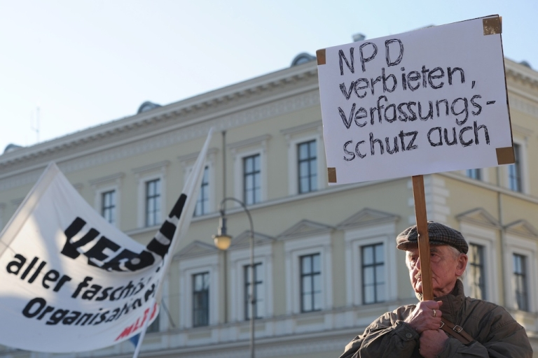<p>A man holds a banner calling for the ban of the neo-Nazi National Democratic Party of Germany (NPD) and the closure of Federal Office for the Protection of the Constitution on Nov. 19, 2011 in Munich, during an anti neo-Nazi protest.</p>