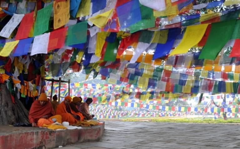 <p>Nepalese Buddhists monks pray outside the Mayadevi (Buddha's mother) temple, birth place of Lord Buddha, Lumbini 400 kms (250 miles) south west of Kathmandu on January 4, 2011.Lord Buddha was born in Lumbini.</p>