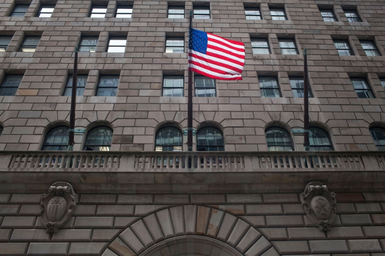 <p>A US flag flies over the entrance to the Federal Reserve Bank of New York on July 29, 2011. A Bangladeshi native was arrested Oct. 17, 2012, in an alleged plot to blow up the building, authorities say.</p>
