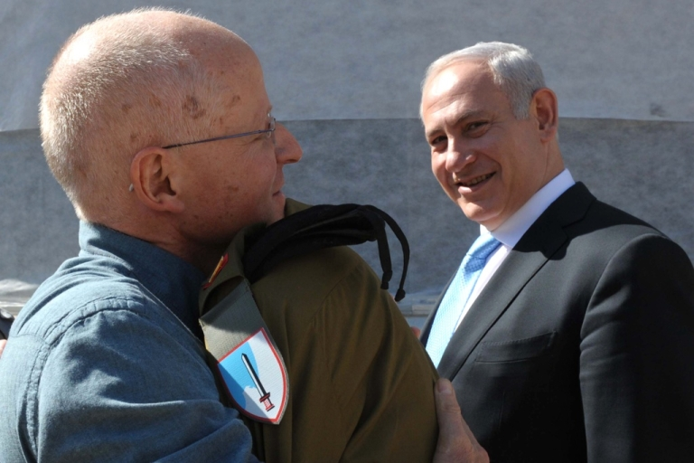 <p>A handout picture released by the Israeli government shows Israeli soldier Gilad Shalit hugging his father Noam for the first time in five years as Israeli Prime Minister Benjamin Netanyahu watches on.</p>