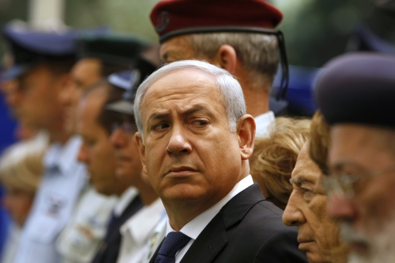 <p>Israel's Prime Minister Benjamin Netanyahu, center, and President Shimon Peres, 2nd right, attend a Memorial Day ceremony commemorating Israeli civilians killed in war and other conflicts, at the Mount Herzl military cemetery in Jerusalem on May 9, 2011.</p>