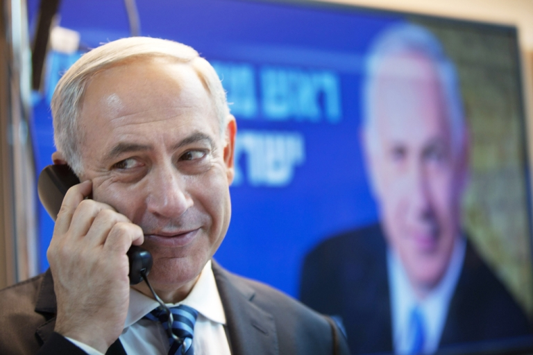 <p>Israeli Prime Minister Benjamin Netanyahu speaks on the phone with potential voters ahead of the upcoming Israeli elections on January 17, 2013. in Tel Aviv, Israel. Israeli elections are scheduled for January 22 and so far showing a majority for the Israeli right.</p>