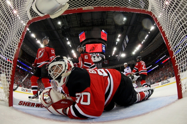 <p>Martin Brodeur, No. 30 of the New Jersey Devils, looks on after making a save against the New York Rangers in Game Six of the Eastern Conference Final during the 2012 NHL Stanley Cup Playoffs at the Prudential Center on May 25, 2012 in Newark, New Jersey.</p>