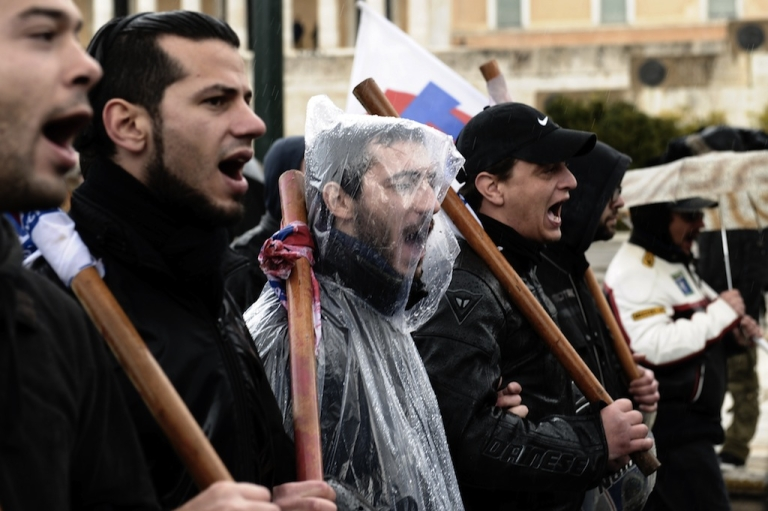 <p>Protesters shout slogans during a 24-hour general strike in Athens on February 7, 2012. A general strike gripped Greece in protest against new austerity measures demanded with increasing urgency by the European Union as part of a debt rescue deal with banks.</p>