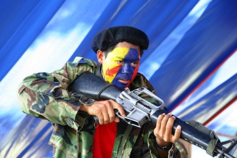 <p>A New People's Army guerrilla performs a play during the 42nd anniversary of the Communist Party of the Philippines at a remote village in the southern island of Mindanao on December 26, 2010.</p>