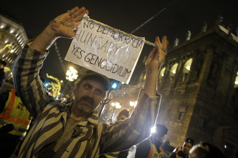 <p>A Hungarian citizen protests against Hungary's new constitution which critics say curbs democracy.</p>