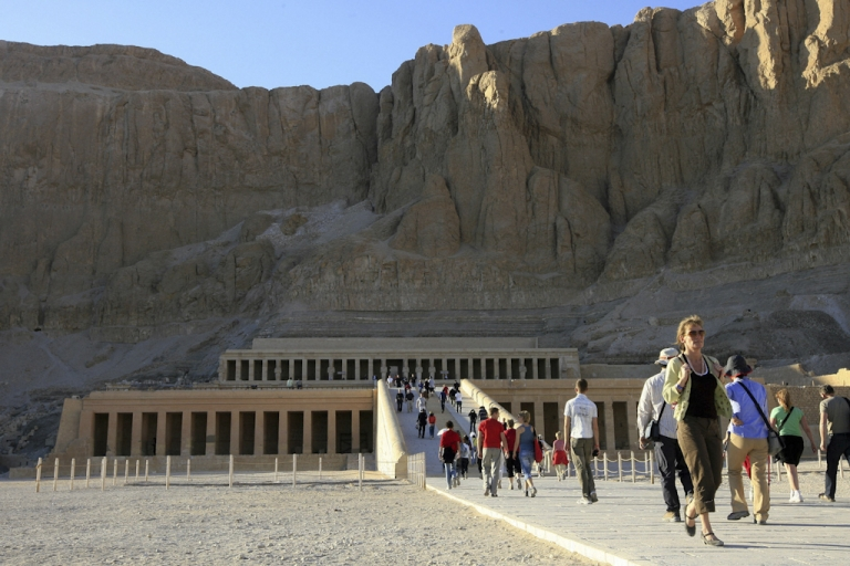 <p>Tourists visit the Temple of Queen Hapshepsut at Deir el-Bahari in Luxor, Egypt.</p>