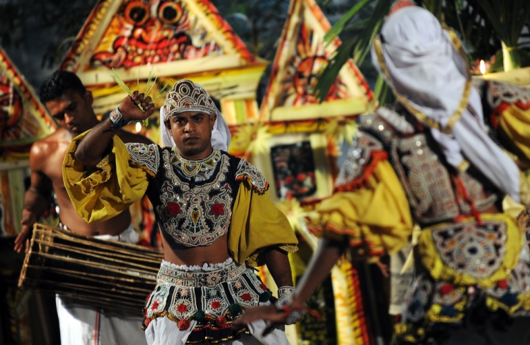 <p>A Sri Lankan traditional dancer performs in Colombo on December 31, 2011. The ceremony was conducted to ward off bad spirits in the 2012 New Year.</p>