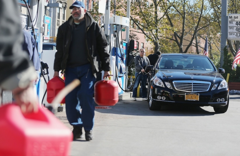 <p>New Yorkers filling up in Manhattan on the first day of gas rationing on November 9, 2012.</p>