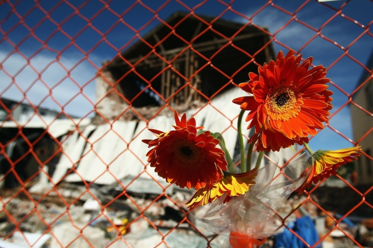 <p>Flowers are left outside a building where a 74-year-old brick layer died after being trapped in his car on Feb. 27, 2011, in Christchurch, New Zealand.</p>