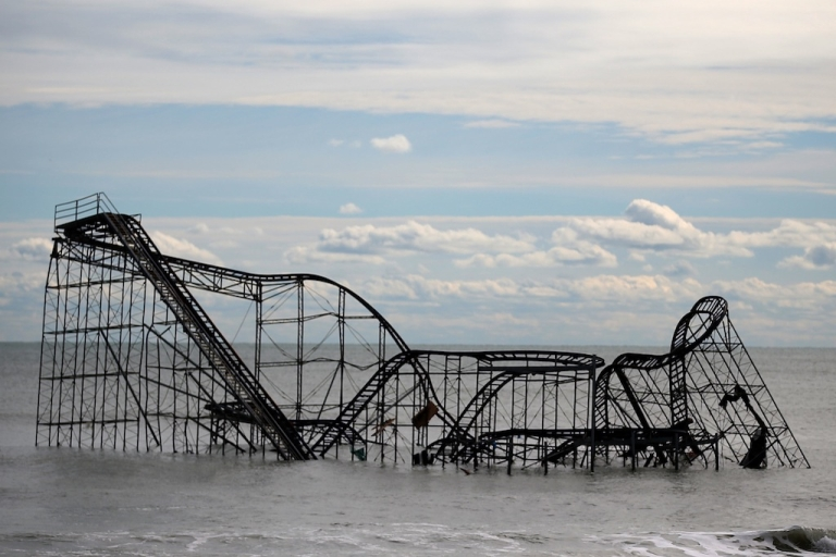 <p>The Seaside Heights roller coaster sits destroyed in the middle of the ocean after Superstorm Sandy rolled through New Jersey. Some climate specialists believe a series of events caused by a record Arctic ice melt contributed to the severity and direction of the storm.</p>