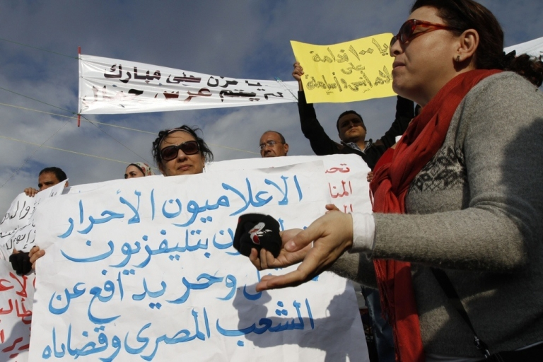 <p>Egyptian anti-government journalists gather at Cairo's Tahrir Square calling for the ouster of Hosni Mubarak on Feb. 10. They were later joined by many journalists in the government media.</p>