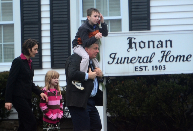 <p>Mourners leave the Honan Funeral Home today after attending a service for Jack Pinto, one of the victims of Friday's mass shooting.</p>