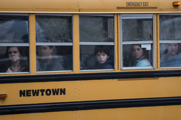 <p>A school bus takes students to Newtown High School on December 18, 2012 in Connecticut. Students in Newtown, excluding Sandy Hook Elementary School, return to school for the first time since last Friday's shooting at Sandy Hook which took the live of 20 students and 6 adults.</p>