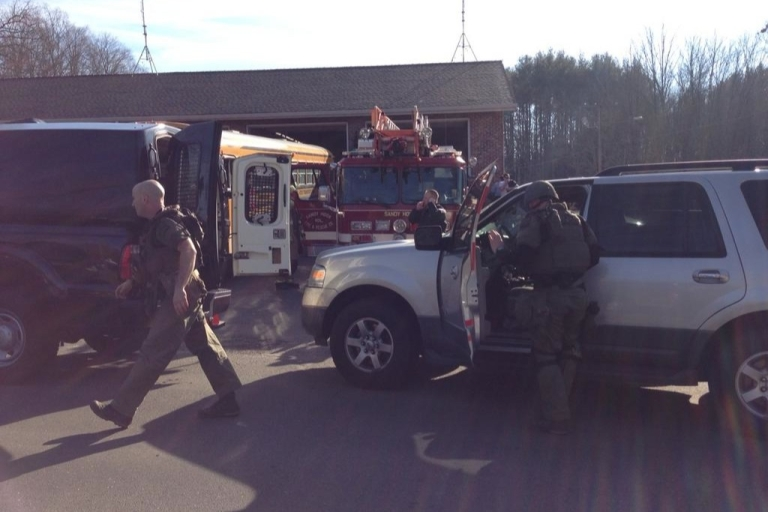 <p>This photo uploaded to Twitter by NBC reporter Liz Dahlem shows Connecticut state police arriving at the scene of an elementary school shooting in Newtown.</p>