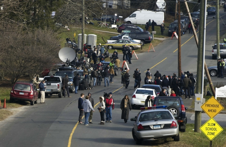 <p>Media and residents gather near the entrance to the Sandy Hook Elementary School on December 15, 2012 in Newtown, Connecticut. The residents of an idyllic Connecticut town were reeling in horror from the massacre of 20 small children and six adults in one of the worst school shootings in US history.</p>