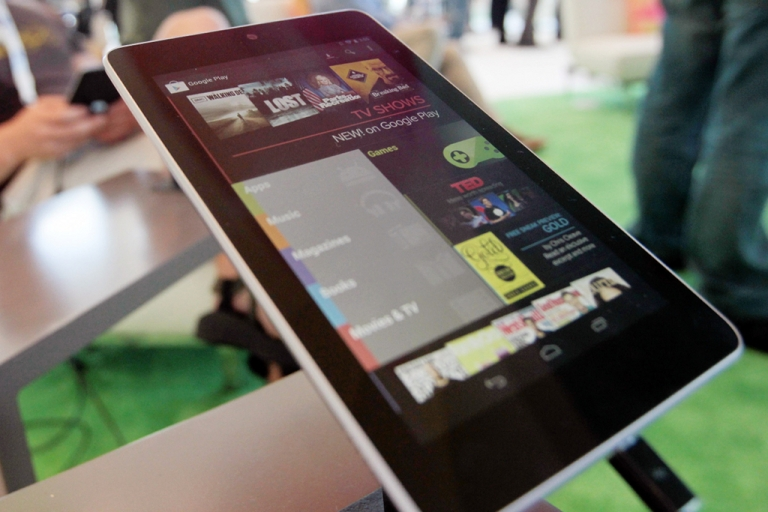 <p>SAN FRANCISCO, CA - JUNE 27:  A Nexus 7 tablet is ready for use at the Google Developers Conference as developer Brad McManus tries out the new device on June 27, 2012 in San Francisco, California. Google may release a $99 version of the tablet by the end of 2012.</p>