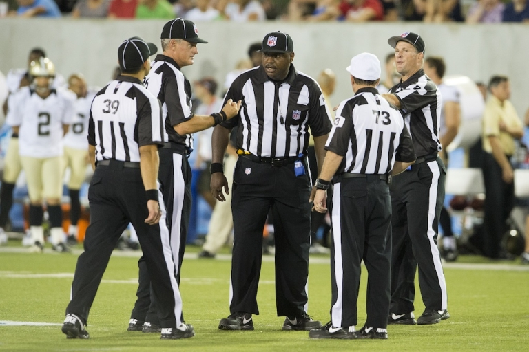 <p>Game officials discuss the running of a play during the second half of the Pro Football Hall of Fame game at Fawcett Stadium on August 5, 2012 in Canton, Ohio. On Thursday, the first female ref will join their ranks.</p>