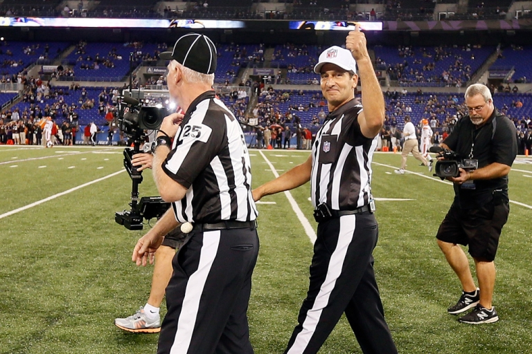 <p>Game officials Bob Waggoner, left, and Gene Steratore take the field for the first time this season before the start of the Baltimore Ravens and Cleveland Browns game at M&amp;T Bank Stadium on September 27, 2012 in Baltimore, Maryland.</p>