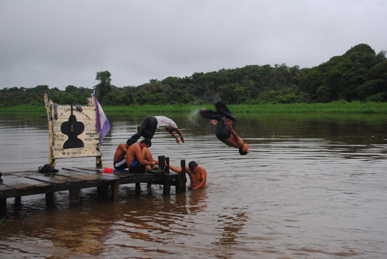 <p>Nicaraguan kids take turns jumping in the water at a camp for Sandinista youths built in an area disputed by Costa Rica.</p>